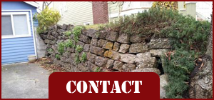 House with Rocky Wall - Concrete Contractor